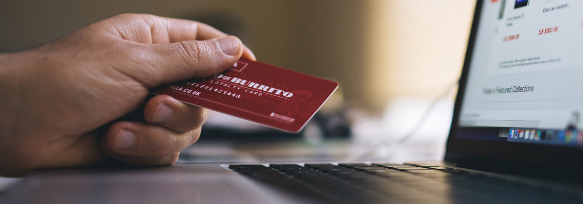 Man with credit card in his hand